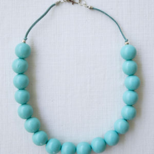 Bauble on suede pastel blue
